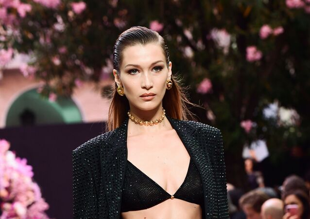 US model Bella Hadid model presents a creation for fashion house Versace during the presentation of its women's and men's spring/summer 2020 fashion collection in Milan on June 15, 2019