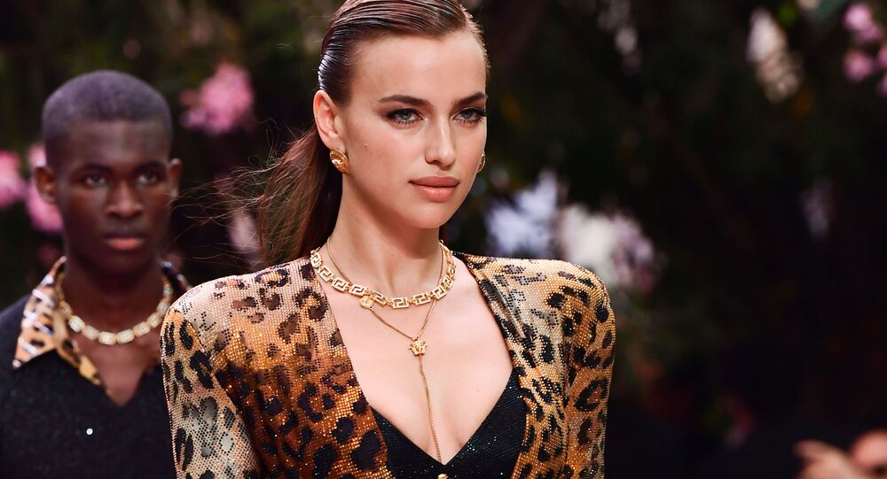 Russian model Irina Shayk presents a creation for fashion house Versace during the presentation of its women's and men's spring/summer 2020 fashion collection in Milan on June 15, 2019