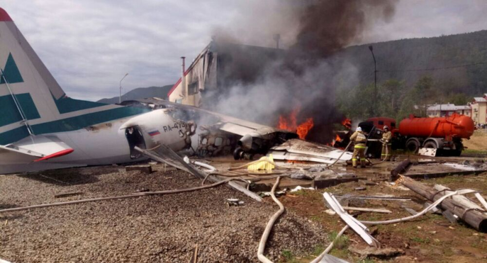 An Antonov An-24 passenger plane is seen on fire after an emergency landing in the town of Nizhneangarsk, Russia June 27, 2019