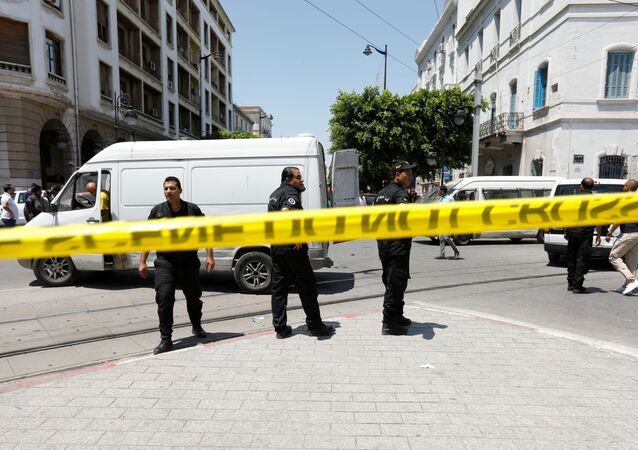 Police officers stand guard at the site of an explosion in downtown Tunis, Tunisia, June 27, 2019