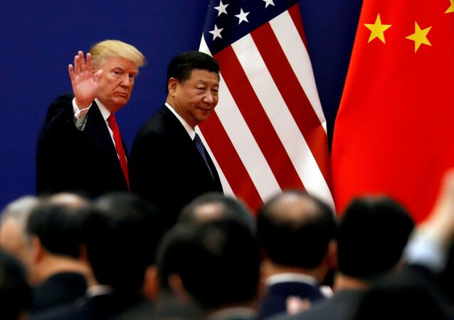 U.S. President Donald Trump and China's President Xi Jinping meet business leaders at the Great Hall of the People in Beijing, China, November 9, 2017