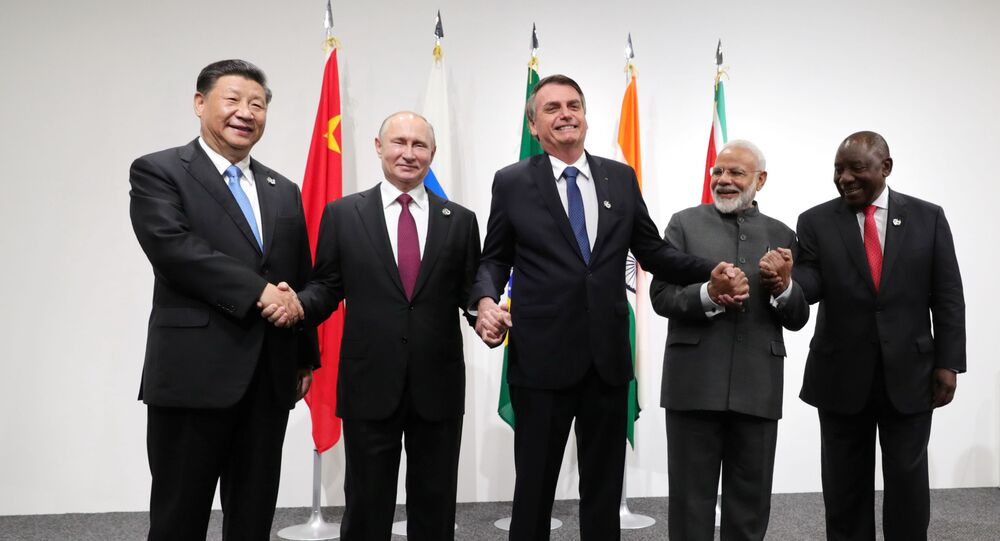 Russia's President Vladimir Putin (2nd L), Brazil's President Jair Bolsonaro (C), India's Prime Minister Narendra Modi (2nd R), China's President Xi Jinping (L) and South Africa's President Cyril Ramaphosa pose for a picture during the BRICS summit in Osaka, Japan June 28, 2019