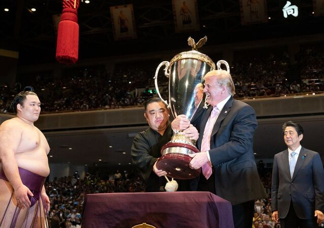 US President Donald Trump and Japan's Prime Minister Shinzo Abe attend the Sumo Grand Championship, where Trump participates in the presentation of trophies at Ryōgoku Kokugikan Stadium in Tokyo on 27 May 2019