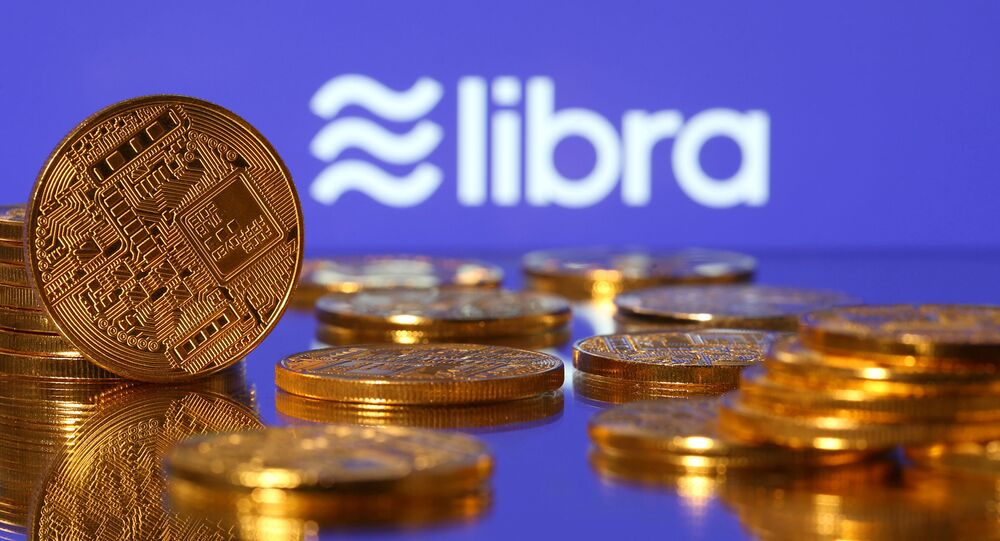 Representations of virtual currency are displayed in front of the Libra logo in this illustration picture, June 21, 2019