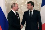 Russian President Vladimir Putin Shakes Hands with French President Emmanuel Macron