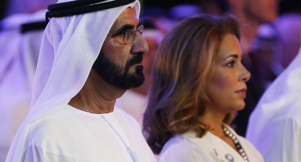 UAE Prime Minister and Dubai Ruler Sheikh Mohammed bin Rashid al-Maktoum (L) stands next to his wife Princess Haya bint al-Hussein during the presentation of a UN report on funding for humanitarian aid on January 17, 2016, in the Emirate of Dubai.