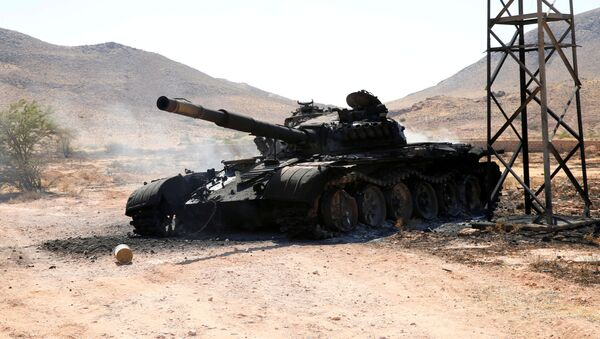 A destroyed and burnt tank, that belongs to the eastern forces led by Khalifa Haftar, is seen in Gharyan south of Tripoli Libya June 27, 2019.  - Sputnik International