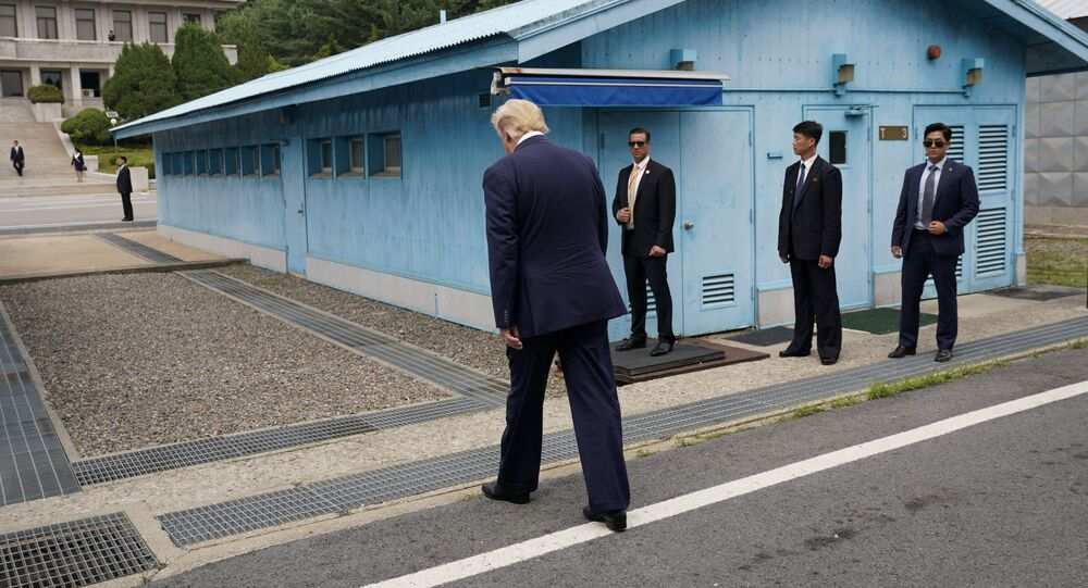 U.S. President Donald Trump walks to meet with North Korean leader Kim Jong Un at the demilitarized zone separating the two Koreas, in Panmunjom, South Korea, June 30, 2019.