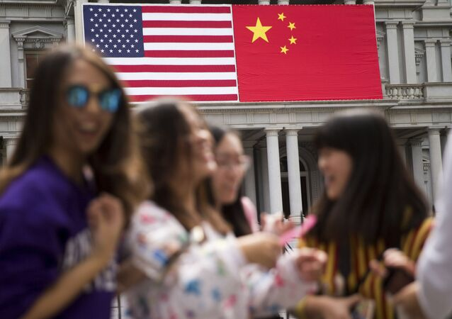 In this Thursday, 24 September 2015 photo, China's flag is displayed next to the American flag on the side of the Old Executive Office Building on the White House complex in Washington, the day before a state visit by Chinese President Xi Jinping