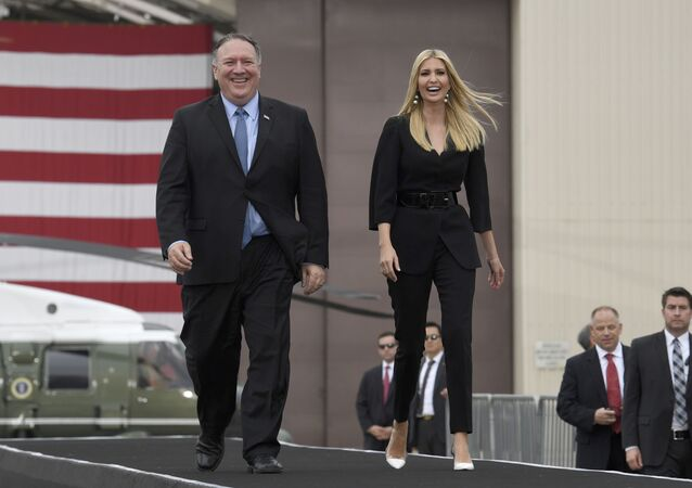 U.S. Secretary of State Mike Pompeo, left, and Ivanka Trump, right, walk to join President Donald Trump on stage as he to speaks to troops at Osan Air Base in South Korea, 30 June  2019.