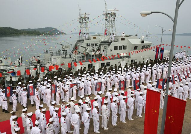 Cambodian naval personel stand as they wait for the welcoming delegation for a handover ceremony for nine naval patrol boats donated by China, at the Cambodia Naval Base in Sihanouk Ville, some 220 kilometers south-west of Phnom Penh, 07 November 2007.