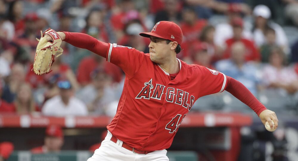 Los Angeles Angels starting pitcher Tyler Skaggs throws to the Oakland Athletics