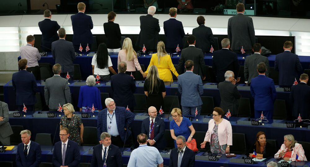 Members of the Brexit Party turn their back to the assembly as the European anthem is played during the first plenary session of the newly elected European Parliament in Strasbourg, France