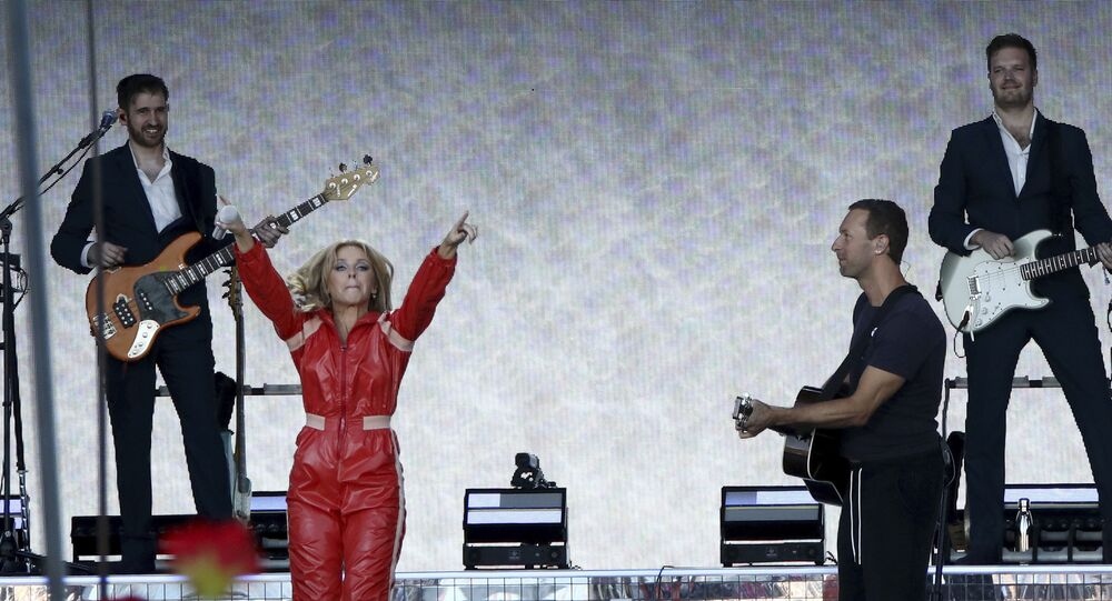 Kylie Minogue and Chris Martin perform together on the final day of the Glastonbury Festival on 30 June 2019