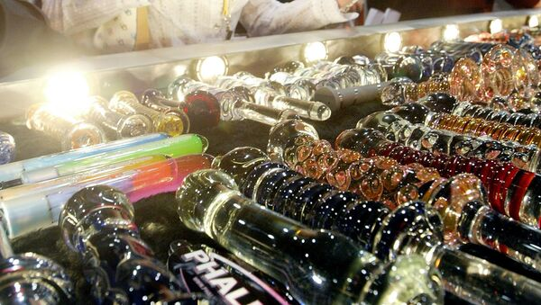 A woman looks at a glass dildo made by Phallix at the AVN Adult Entertainment Expo 09 January, 2004 in Las Vegas - Sputnik International