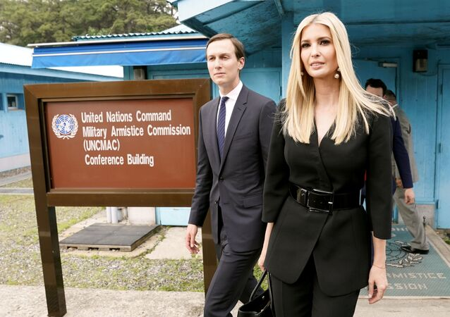 White House senior advisors Ivanka Trump and Jared Kushner walk at the demilitarized zone separating the two Koreas, in Panmunjom, South Korea, June 30, 2019
