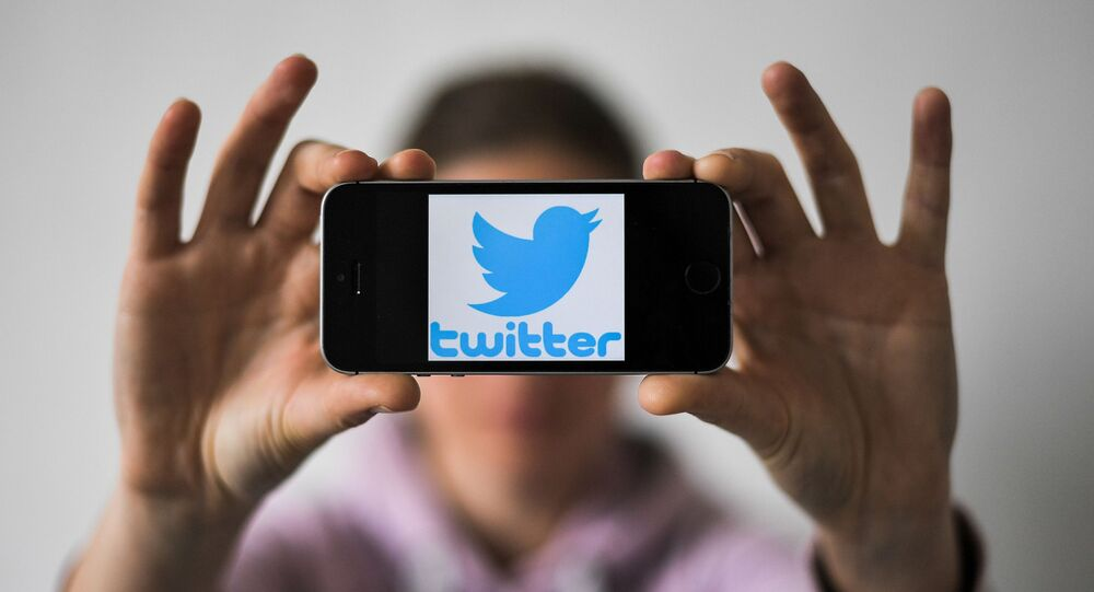 A woman holds a smartphone with the logo of US social network Twitter, on May 2, 2019 in Nantes, western France