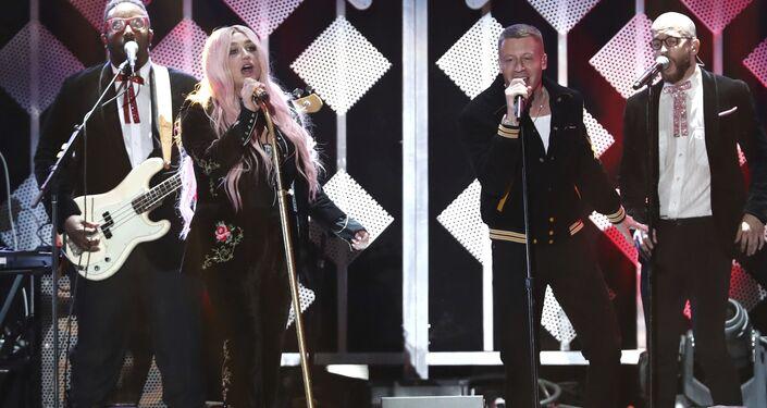 Kesha, left, and Macklemore perform at Jingle Ball at The Forum in Inglewood, California in December 2017