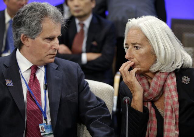 International Monetary Fund (IMF) Managing Director Christine Lagarde, right, speaks with First Deputy Managing Director of the International Monetary Fund, David Lipton