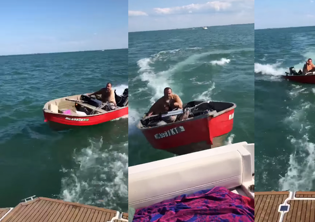 Timothy Kennedy, seen operating the red skiff, faces charges of operating while intoxicated (OWI) and malicious destruction of property.