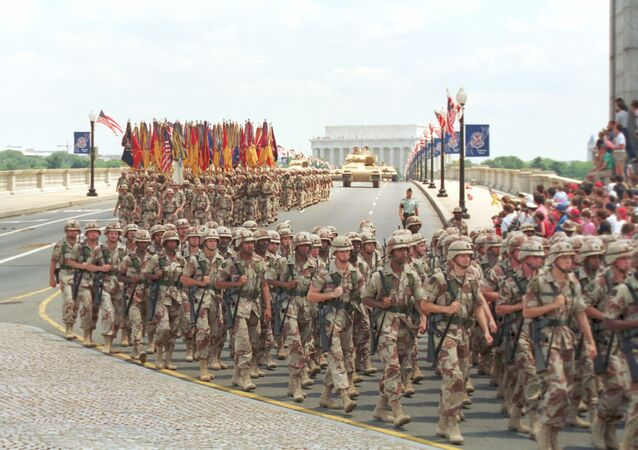 Troops march over the Memorial Bridge in Washington, D.C., as they head towards the Pentagon during the National Victory Day Parade on Saturday, June 8, 1991