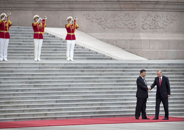 Chinese President Xi Jinping, left, shakes hands with Turkish President Recep Tayyip Erdogan