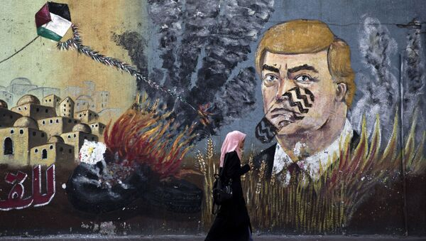 A wall with graffiti depicts U.S. President Donald Trump with a footprint on his face in Gaza City, Tuesday, June 25, 2019 - Sputnik International
