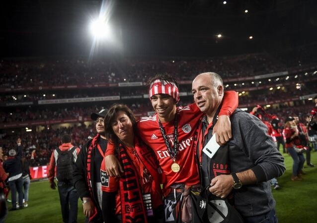 Joao Felix poses with his parents after Benfica won the Portuguese League in May 2019