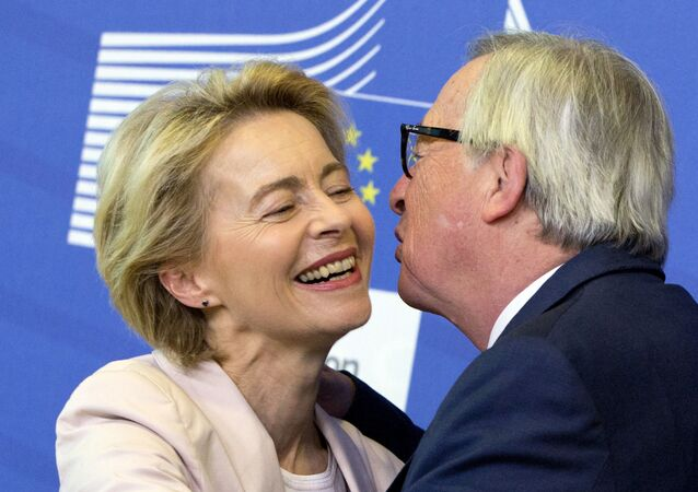 Germany's Ursula von der Leyen is welcomed by European Commission President Jean-Claude Juncker prior to a meeting at EU headquarters in Brussels, Thursday July 4, 2019