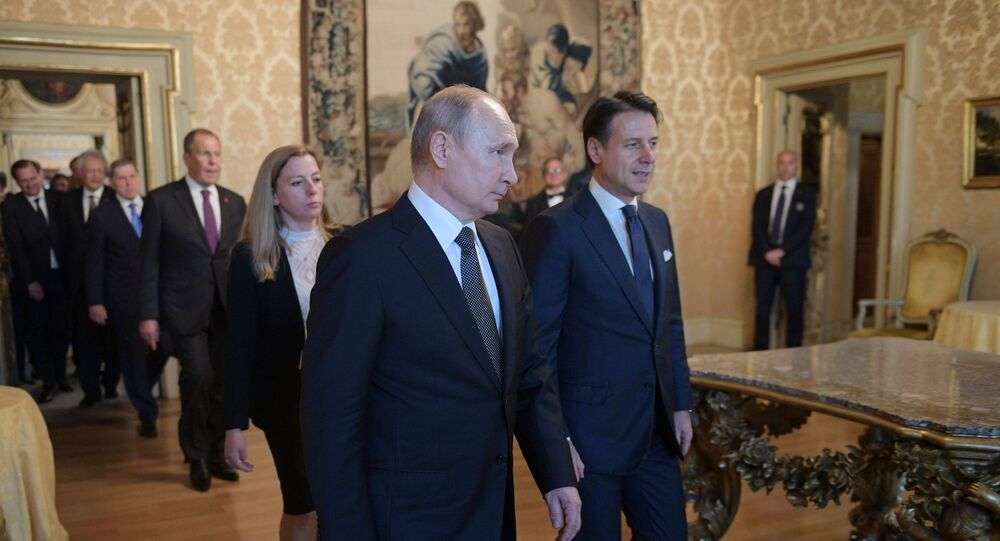 Russian President Vladimir Putin and Italian Prime Minister Giuseppe Conte walk before their meeting at the Chigi Palace in Rome, Italy. Putin is on one-day official visit to Italy.