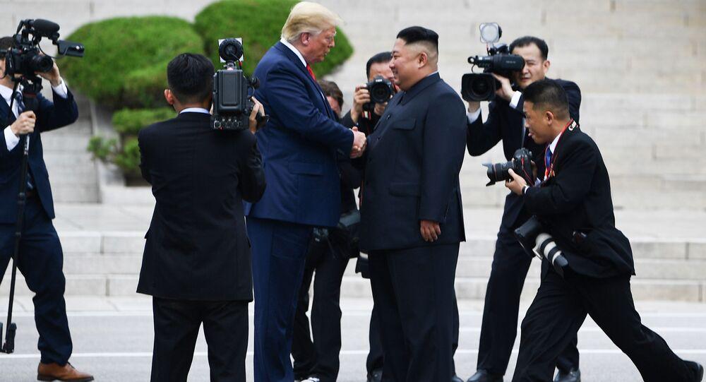 North Korean leader Kim Jong-un shakes hands with US President Donald Trump