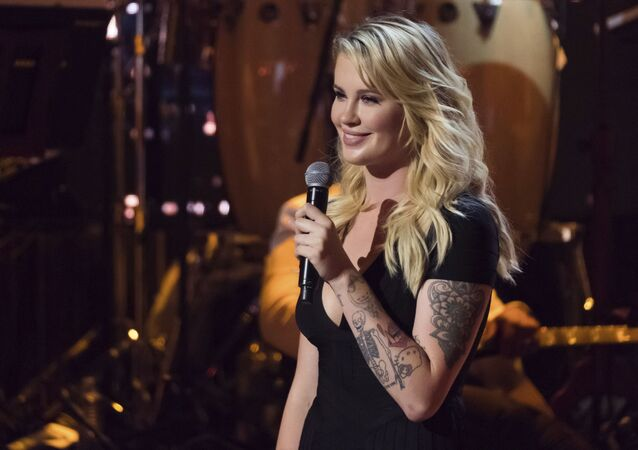 Ireland Baldwin speaks on stage at Spike TV's One Night Only: Alec Baldwin at the Apollo Theater on Sunday, June 25, 2017, in New York