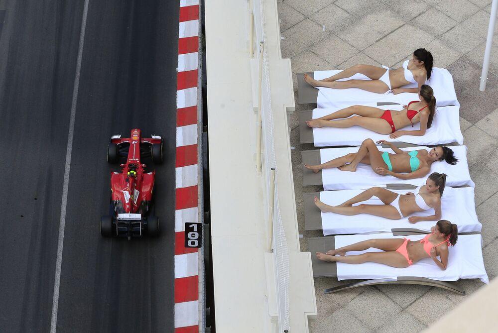 Girls sunbathing during a race in Monaco