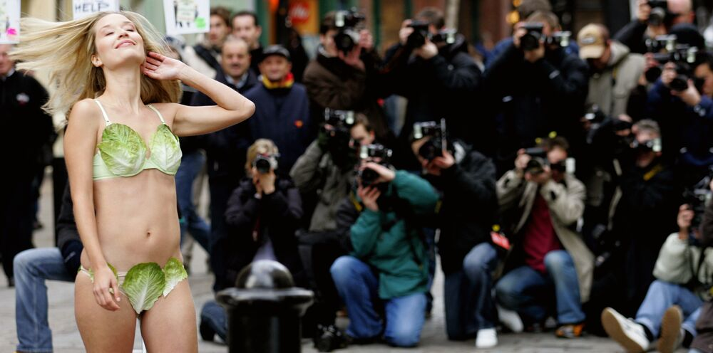 Miss United Kingdom, Brooke Johnston,  posing for photographers in a bikini made from lettuce