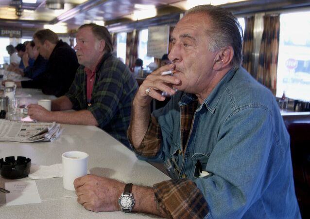 A man smokes a cigarette with his morning coffee at a diner in Syracuse in 2003, before New York state banned smoking in bars and restaurants