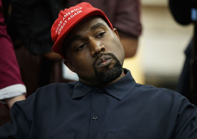 Rapper Kanye West listens to a question from a reporter during a meeting in the Oval Office of the White House with President Donald Trump, Thursday, Oct. 11, 2018, in Washington