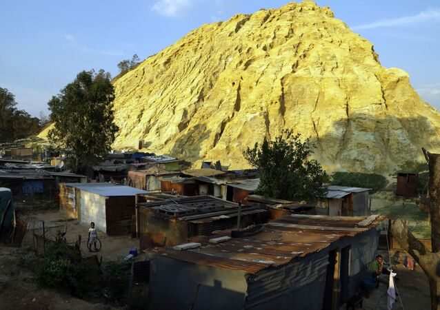 Shacks built below a gold mine dump in the Jerusalem squatter settlement, east of Johannesburg, South Africa, Tuesday, Oct. 28, 2014