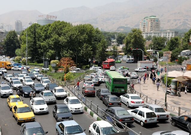 Cars drive through a busy road in the Iranian capital Tehran on July 3, 2019