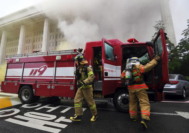 Firefighters participate in an anti-terror drill at the National Assembly in Seoul on August 23, 2017