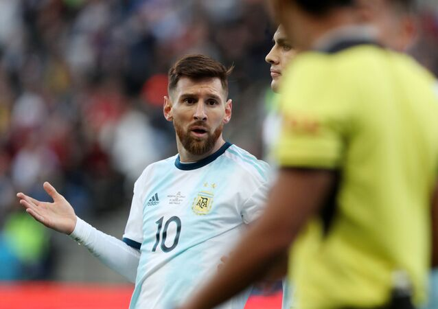 Argentina's Lionel Messi reacts after being shown a red card by referee Mario Diaz de Vivar