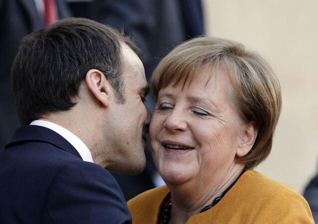 French President Emmanuel Macron Kisses German Chancellor Angela Merkel