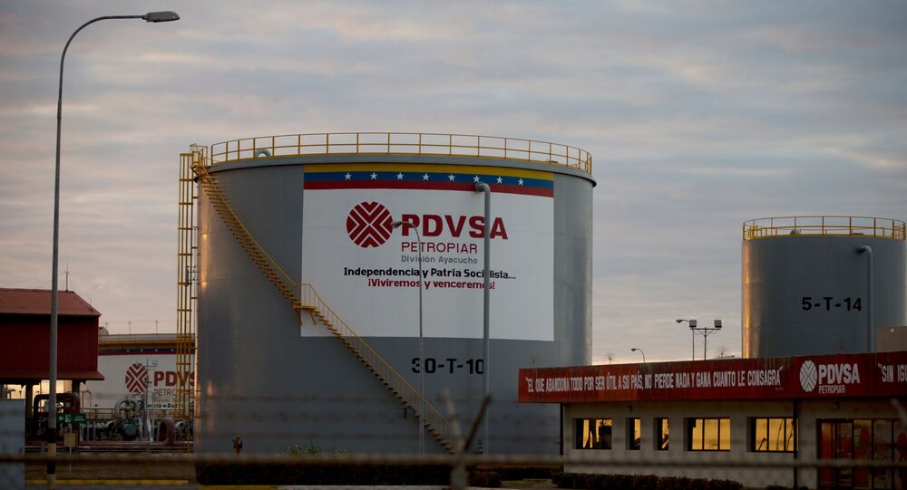 In this Feb. 18, 2015 photo, storage tanks stand in a PDVSA state-run oil company crude oil complex near El Tigre, a town located within Venezuela's Hugo Chavez oil belt, formally known as the Orinoco Belt