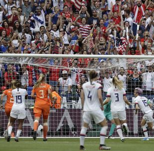 United States' Megan Rapinoe, 2nd right, celebrates with teammates after scoring her side's opening goal during the Women's World Cup final soccer match between US and The Netherlands at the Stade de Lyon in Decines