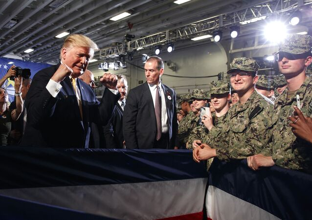 President Donald Trump greets troops after speaking at a Memorial Day event aboard the USS Wasp in Yokosuka, Japan