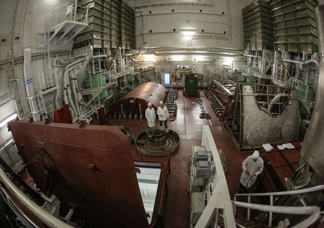 Employees work at the Akademik Lomonosov nuclear power plant (NPP) at the port of Murmansk, Russia.