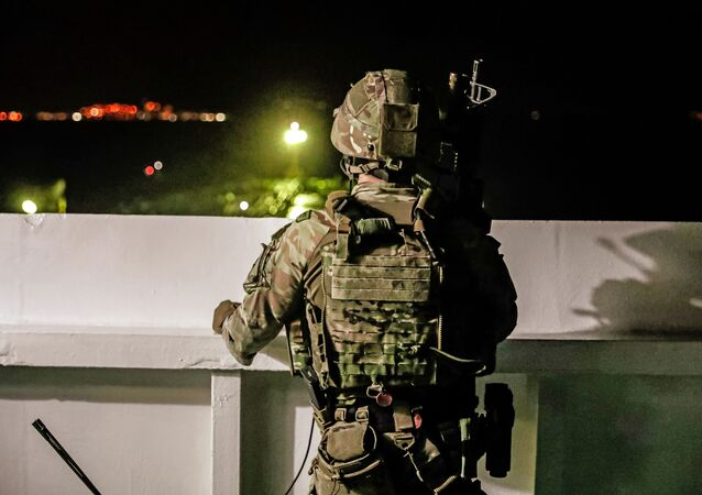 A British soldier looks on during an operation involving the oil supertanker Grace 1, that's on suspicion of carrying Iranian crude oil to Syria, in waters off the British overseas territory of Gibraltar, historically claimed by Spain, July 4, 2019. Picture taken July 4, 2019