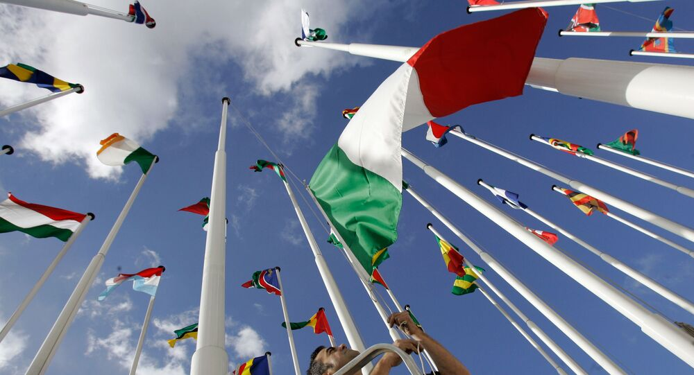 A worker hoists Italy's flag along with the flags of the European Union and African countries participating in the EU-Africa summit Friday, Dec. 7, 2007, in Lisbon