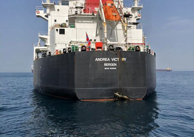 A picture taken on May 13, 2019 off the coast of the Gulf emirate of Fujairah shows Norwegian oil tanker Andrea Victory, one of the four tankers damaged in alleged sabotage attacks in the Gulf the previous day