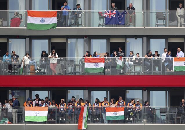 Indian and New Zealand supporters watch the Cricket World Cup semi-final match