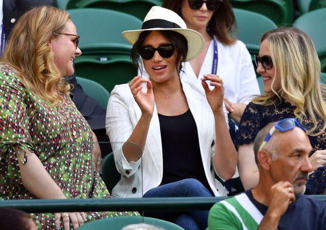 Britain's Meghan (C), Duchess of Sussex watches US player Serena Williams playing against Slovakia's Kaja Juvan during their women's singles second round match on the fourth day of the 2019 Wimbledon Championships at The All England Lawn Tennis Club in Wimbledon, southwest London, on July 4, 2019